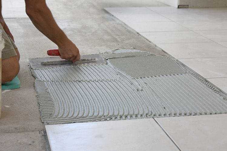 A tiled floor being fitted